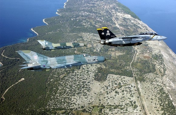 Two MiG-21s accompanying Navy F-14