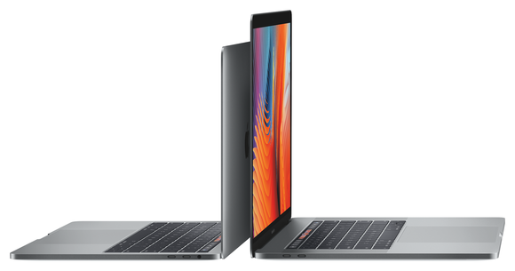 Two Macbooks lined up up back to back.