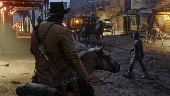Screenshot of in game scene from Red Dead Redemption 2 depicting a man riding into a western town on horseback at night time.