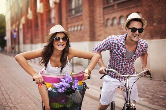 Couple riding bikes on vacation