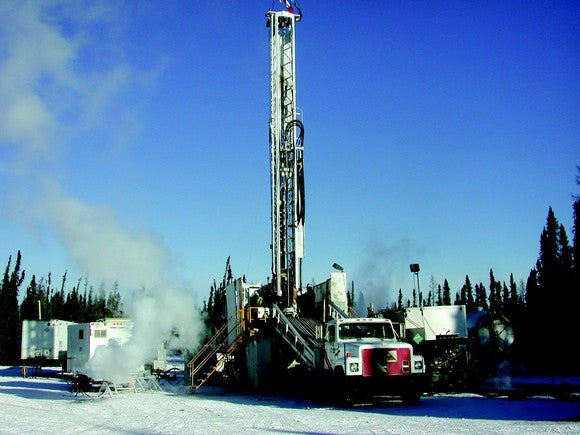 a drilling rig in a winter scene.