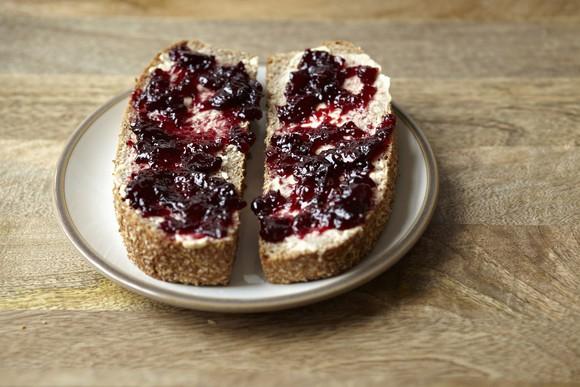 Blueberry jam spread on bread