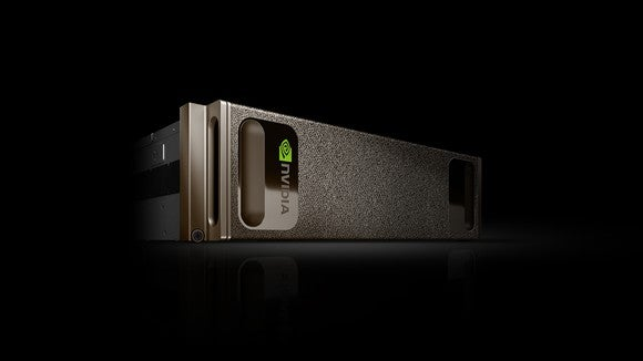 Dark grey aluminum chassis on its side against black ground with NVIDIA logo stamped on its side.