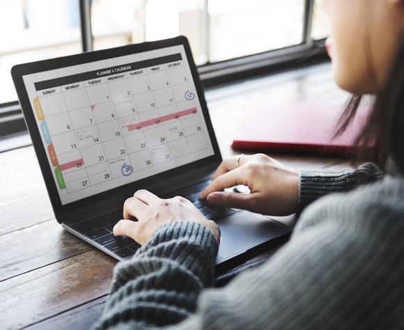 Woman working on calendar on laptop