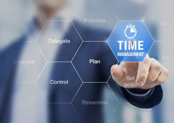 """A man pointing to a """"time management"""" icon"""