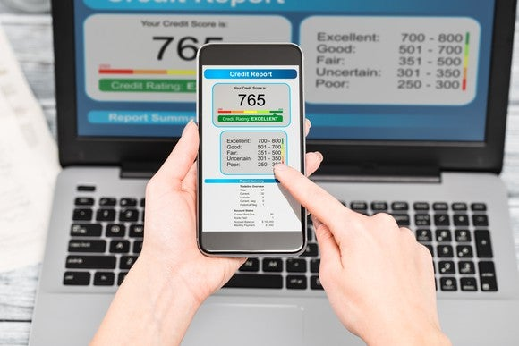 Credit report on a smart phone and laptop.