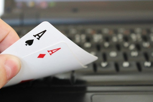 A pair of aces on a computer keyboard