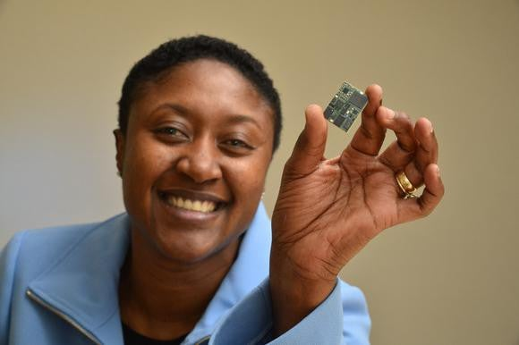 Former Intel cellular modem chief Aicha Evans holding a cellular modem.