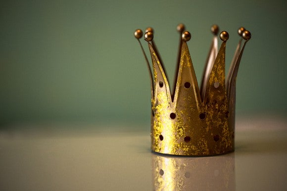 A tiny crown sitting on a table.