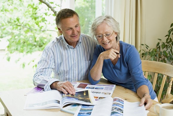 Senior couple looking at travel brochures