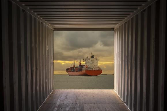 Ship viewed through cargo container