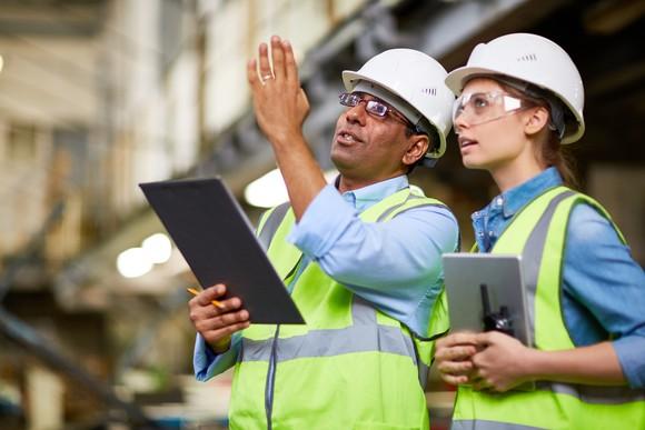 Construction supervisors monitoring a job site