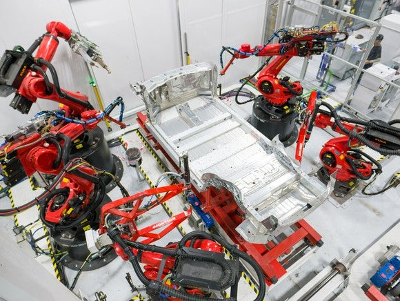Assembly begins on a Tesla vehicle.