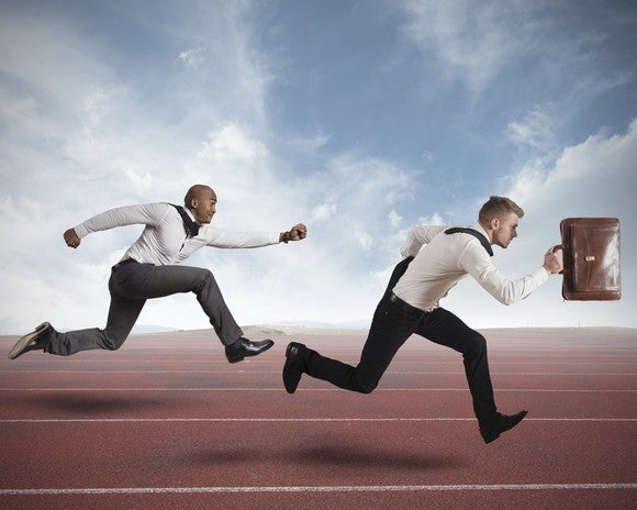 Two businessmen running a race.