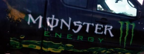 Monster Beverage logo on a truck.