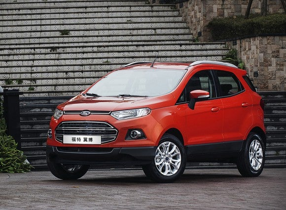 An orange Ford EcoSport SUV with Chinese license plate.
