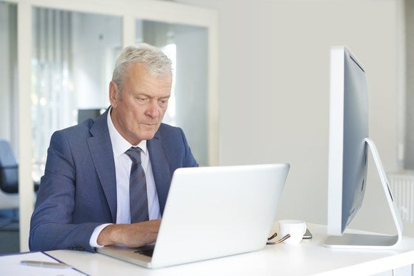 Senior male working at his desk