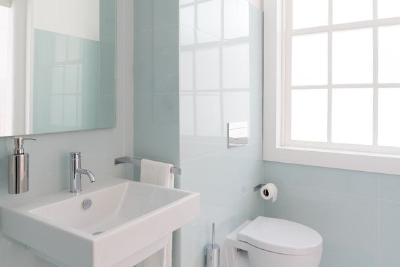 A bathroom showing a sink and toilet