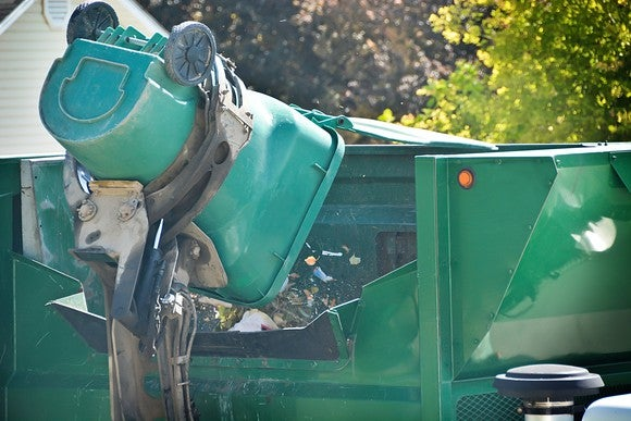A garbage truck emptying a trash bin into its receptacle