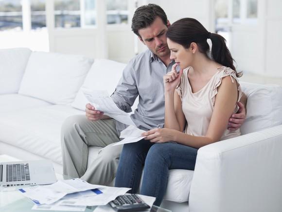 Worried couple looking at healthcare bills