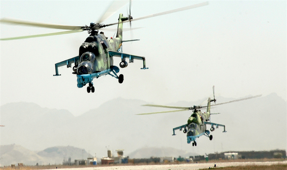 Two Mi-35 Hind's taking off.