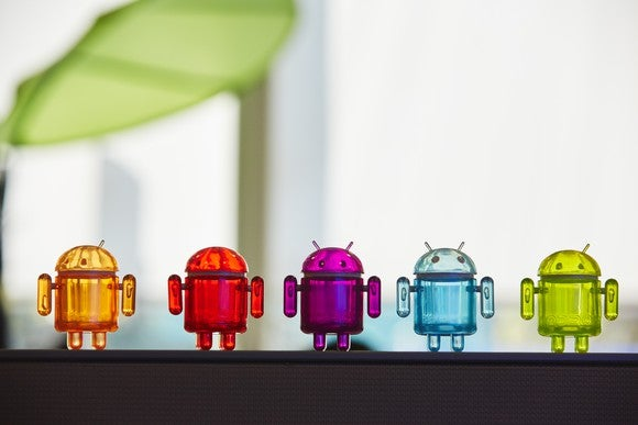 A row of colored transparent Android figurines.
