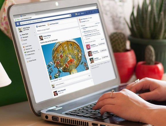 A user checks her Facebook feed on a laptop.