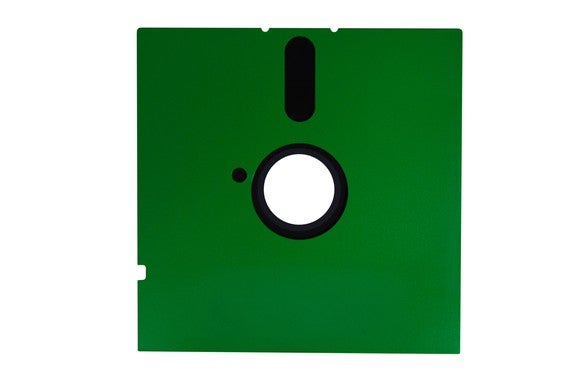 A 5 1/4-inch floppy disk with a green sleeve.
