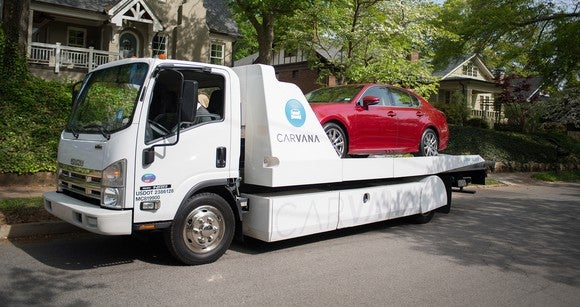 A car being delivered by Carvana's fleet.