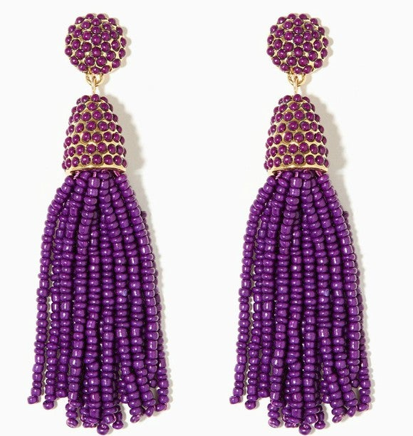 A pair of long purple earrings.