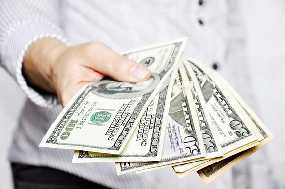 man fanning out bills