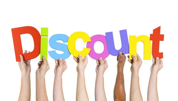 """Hands hold up colorful letters to spell the word """"discount."""""""