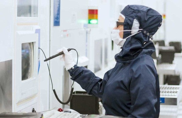 Person working in a semiconductor clean room.