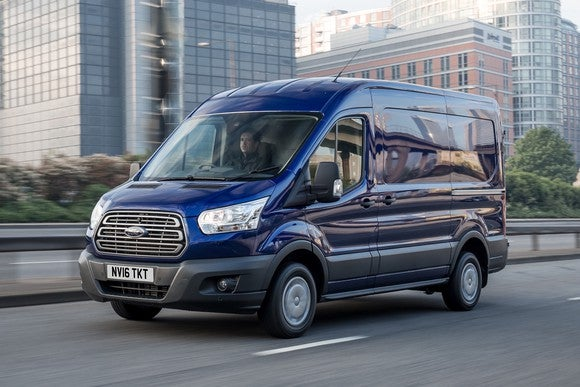 A blue Ford Transit van in London.