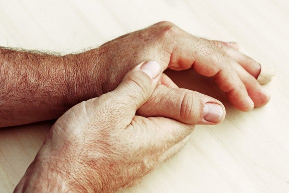 Hands massaging finger joints