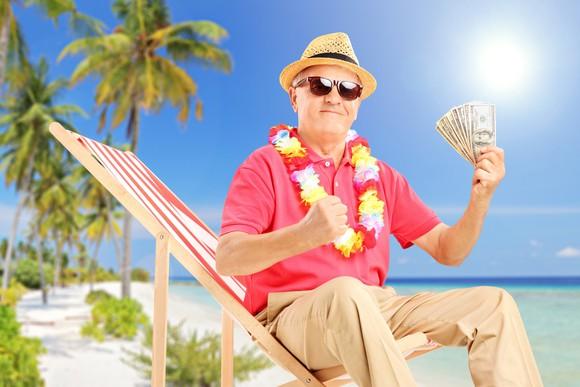 A retiree celebrating on the beach.