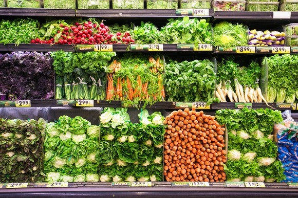 Colorful wall of grocery produce.