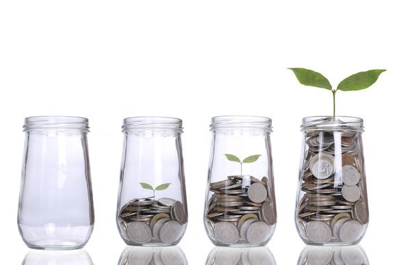 A row of jars with increasing amounts of coins and bigger plants in them.