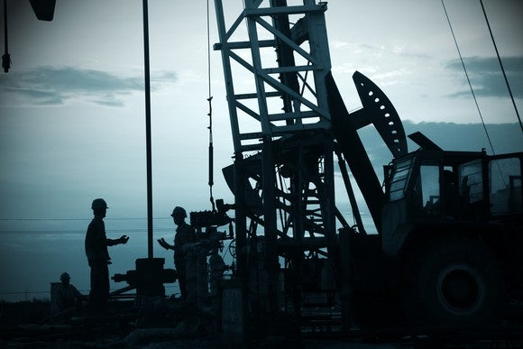 Drilling rig and pumpjack.
