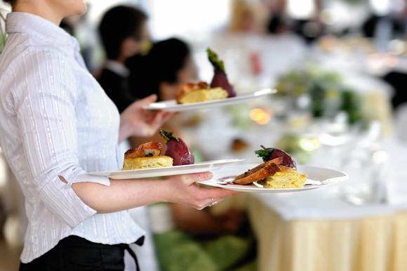 A waitress balances three plates