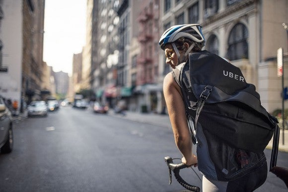A cyclist with an Uber messenger bag