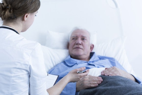 Senior male patient talking to a nurse