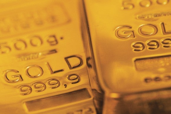 Two gold bars stacked next to each other.