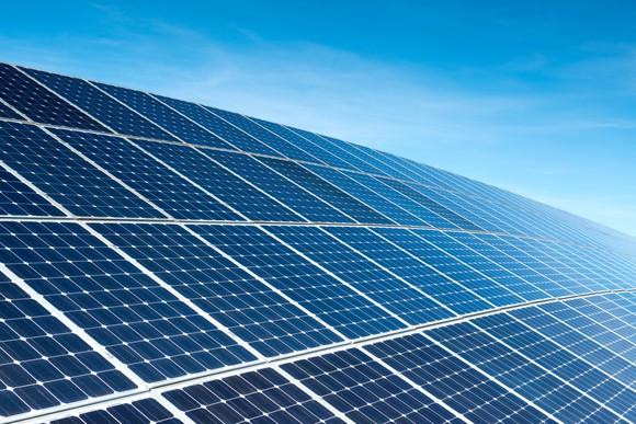 Solar panels in an array on a sunny day.