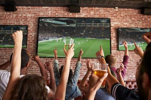 People watching sports on a TV.