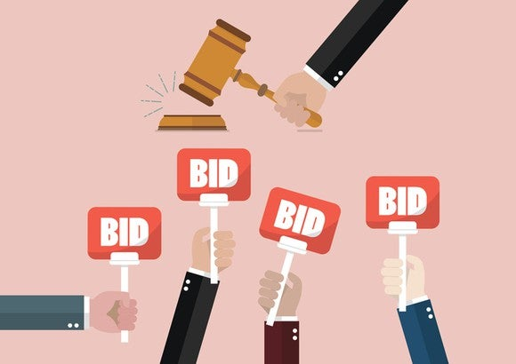 """Vector illustration of hands holding up signs labeled """"Bid"""" as a gavel comes down."""