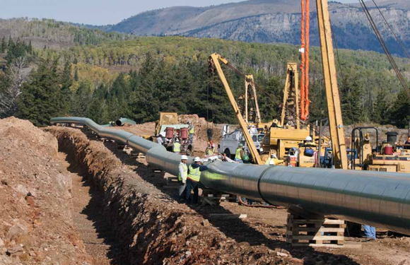 Kinder Morgan laying natural gas transport pipeline.
