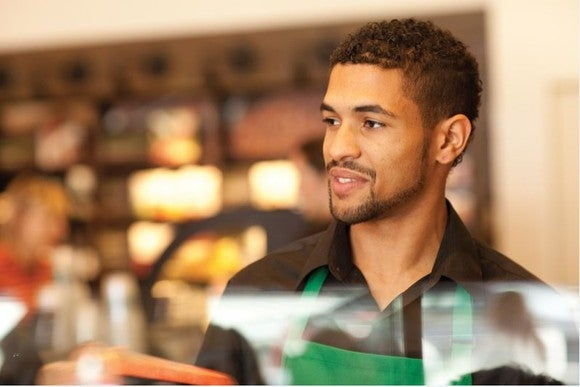 A Starbucks employee working behind the counter.