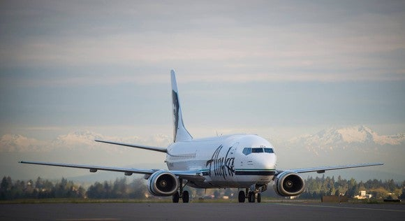An Alaska airplane on the runway.