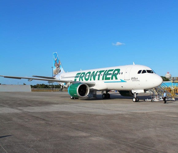 A Frontier airplane on the ground.